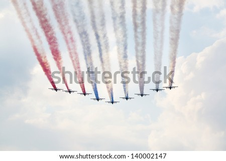 ZHUKOVSKY - AUGUST 12: Aerobatic team at Su-25 aircrafts from Russia at airshow on 100th anniversary of Russian Air Force on August 12, 2012 in Zhukovsky, Moscow region, Russia. - stock photo