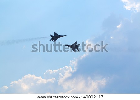 ZHUKOVSKY - AUGUST 12: Two Russian mig-29 aircrafts at airshow on 100th anniversary of Russian Air Force on August 12, 2012 in Zhukovsky, Moscow region, Russia. - stock photo