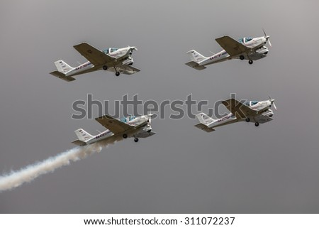ZHUKOVSKY, MOSCOW REGION, RUSSIA - AUGUST 29, 2015: Aerobatic Team ChelAvia on Tecnam P2002 Sierra at WorldWide AirShow MAKS-2015 in Zhukovsky, Moscow region, Russia. - stock photo