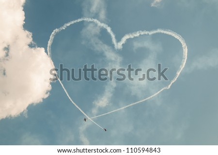 ZHUKOVSKY, MOSCOW REGION/RUSSIA - AUGUST 10: Immersion heart made in sky by team First Flight on Yak-52  at airshow devoted to 100 anniversary of Russian Air Forces on August 10, 2012 in Zhukovsky. - stock photo