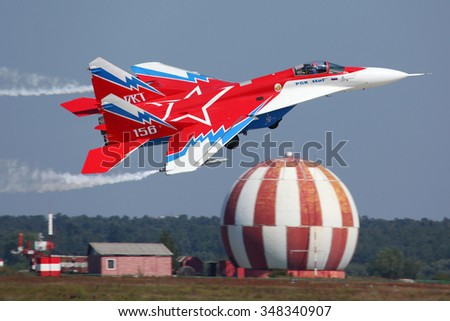 ZHUKOVSKY, MOSCOW REGION, RUSSIA - AUGUST 16, 2011: MiG-29OVT perfoming demonstration flight in Zhukovsky during MAKS-2011 airshow. - stock photo
