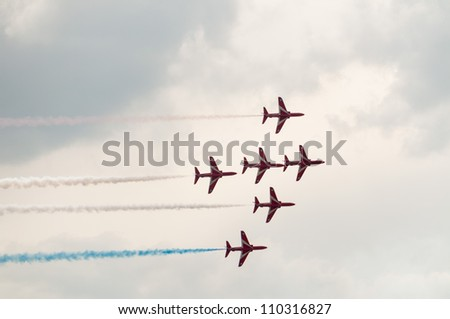 ZHUKOVSKY, MOSCOW REGION/RUSSIA - AUGUST 10: Royal Air Force Aerobatic Team Red Arrows Hawk T1 BAE Systems on airshow devoted to 100 anniversary of Russian Air Forces on August 10, 2012 in Zhukovsky. - stock photo