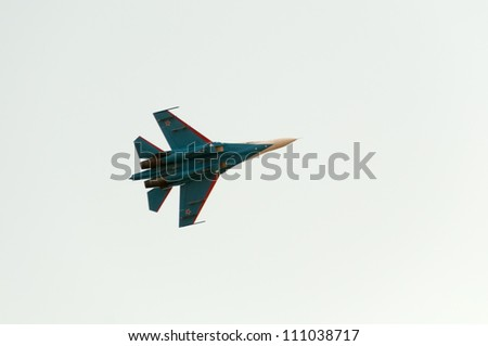 ZHUKOVSKY, MOSCOW REGION/RUSSIA - AUGUST 10: 4 Su-27 Flanker fighters of The Russian Knights aerobatic team. Airshow devoted to 100 anniversary of Russian Air Forces on August 10, 2012 in Zhukovsky. - stock photo
