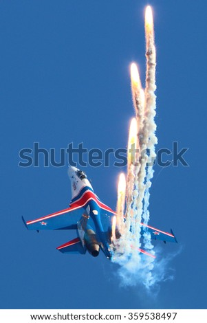 ZHUKOVSKY, MOSCOW REGION, RUSSIA - AUGUST 28, 2015: Sukhoi Su-27 of Russian Knights aerobatics team perfoming demonstration flight in Zhukovsky during MAKS-2015 airshow. - stock photo