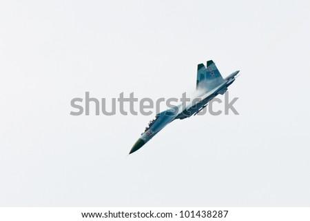 ZHUKOVSKY, RUSSIA - AUG 19: Su-27 from Russkie Vityazi aerobatic display team flies during airshow at International aviation and space salon MAKS 2011 on August 19, 2011 in Zhukovsky, Russia - stock photo