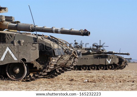 ZIKIM,ISR - JULY 07:Merkava Tanks on July 07 2006.The Mark IV has the Israeli-designed TSAWS system, It designed to endure the harsh basalt rock conditions of Golan Heights with minimal track-shedding - stock photo