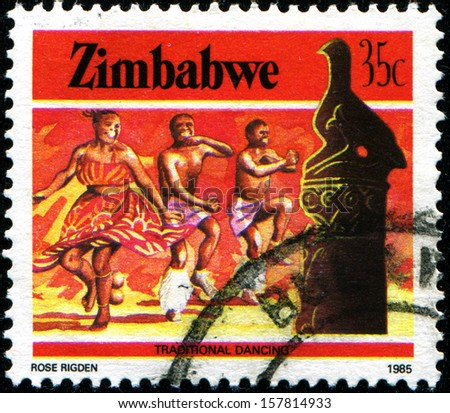 "ZIMBABWE - CIRCA 1985: A stamp printed in Zimbabwe  shows traditional dancing, ""National Infrastructure""  series, circa 1985 - stock photo"