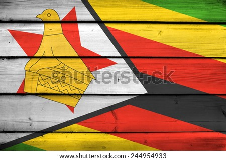 Zimbabwe Flag on wood background - stock photo