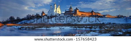 Zimnenskiy Svyatogorskiy the Uspenskiy monastery a?? beautiful  Ukrainian Orthodox Church of Moscow patriarchy  is placed on  Sainted Hills above background river of Meadow (Lug) near a village Zimno - stock photo