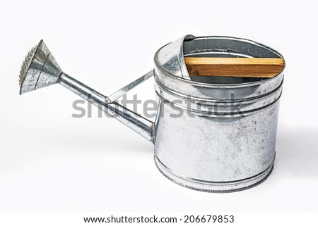 zinc watering can isolated on white.  - stock photo