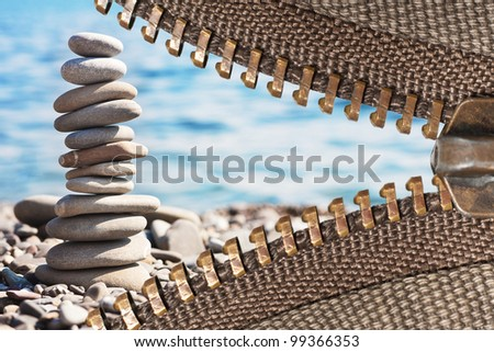 zipper of a camping tent with sea pebbles background - stock photo