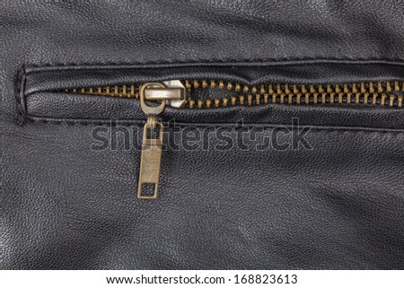 Zipper on a leather  - stock photo