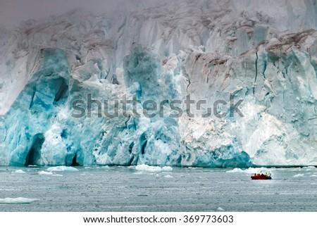 Zodiac near Svalbard Spitzbergen island glacier view landscape panorama - stock photo