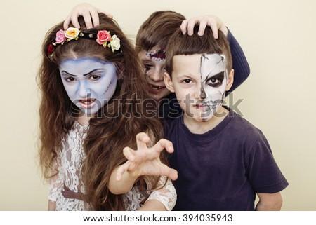 zombie apocalypse kids concept. Birthday party celebration facepaint on children dead bride, scar face, skeleton together - stock photo