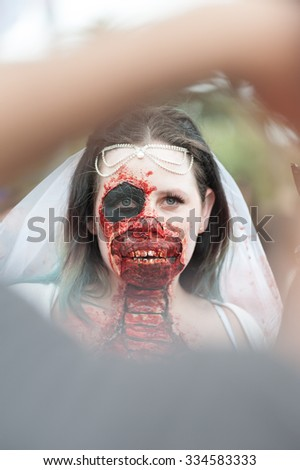Zombie bride at Sydney Zombie Walk in Sydney, AU, 31st October, 2015. Zombie Walk is an annual event where thousands of people get involved to raise awareness for Australia's Brain Foundation. - stock photo