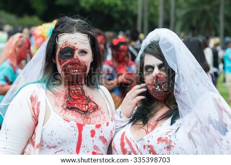 Zombie brides at Sydney Zombie Walk in Sydney, AU, 31st October, 2015. Zombie Walk is an annual event where thousands of people get involved to raise awareness for Australia's Brain Foundation. - stock photo
