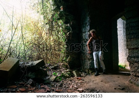 Zombie escaping woman, looking for safe - stock photo