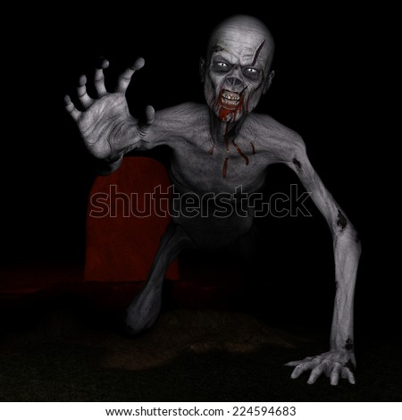Zombie - Rising from the Grave.  A zombie has dug his way out of his grave and looks angry and hungry. Happy Halloween. - stock photo