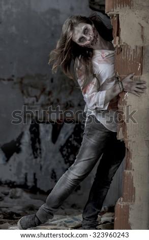 Zombie walking halloween scene - stock photo