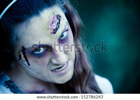 Zombie Woman sneering at the camera close up - stock photo