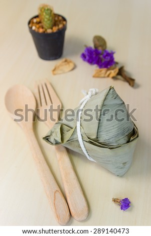 Zongzi Chinese rice dumplings on wooden background - stock photo