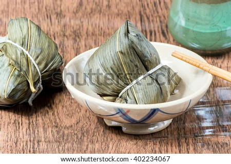 Zongzi or sticky rice dumpling (Chinese Rice Dumplings food) for dragon boat festival - stock photo