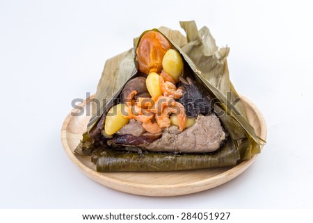Zongzi or sticky rice dumpling in wooden dish on white background - stock photo