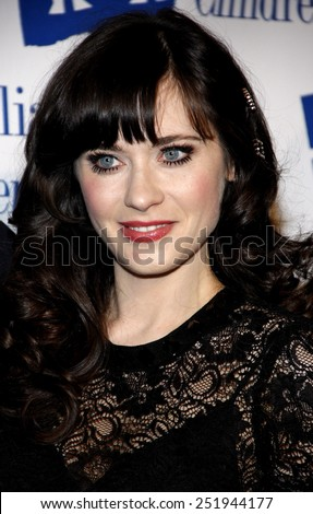Zooey Deschanel at the Alliance for Children's Rights Dinner Honoring Kevin Reilly held at the Beverly Hilton Hotel, California, United States on March 1, 2012.  - stock photo