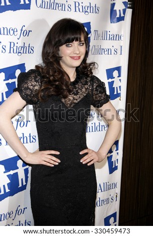 Zooey Deschanel at the Alliance for Children's Rights Dinner Honoring Kevin Reilly held at the Beverly Hilton Hotel in Beverly Hills, USA on March 1, 2012. - stock photo
