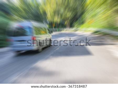 Zoom blur high speed motion van car at the curve road for abstract background. - stock photo