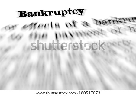 Zooming closeup of definition of the word bankruptcy - stock photo