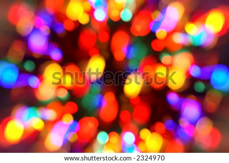 Zooming out on out-of-focus Christmas lights to give it a feeling of movement and motion - stock photo