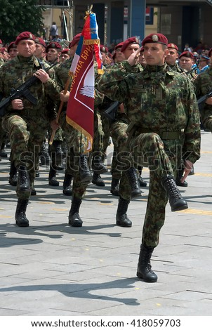 ZRENJANIN - MAY 9th:Serbian Army Special Brigade with brigade flag on Celebration a Victory Day and the Day of the Army of Serbia.May 9,2016 in Zrenjanin, Serbia - stock photo