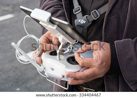 Zrenjanin, SERBIA: October 29, 2015, detail of man flying Dji Inspire 1 remote controller with Ipad on AVIV park opening - stock photo