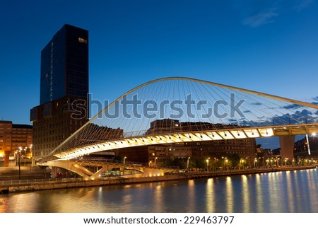 ZUBIZURI BRIDGE - august 04. Zubizuri bridge in the city of Bilbao on august 04, 2011. Zubizuri bridge create by Santiago Calatrava, Abandoibarra, Bilbao, Bizkaia, Spain - stock photo