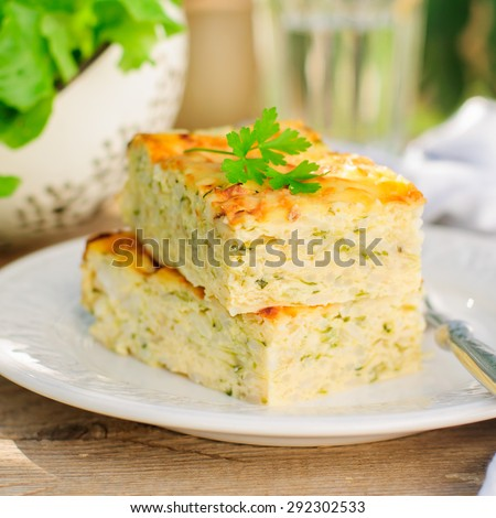 Zucchini Rice Slice with Cheese, square, close up - stock photo