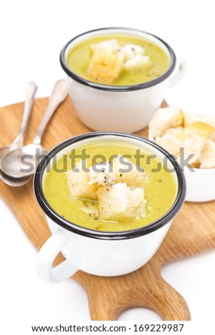 zucchini soup with croutons in a cups, isolated on white - stock photo