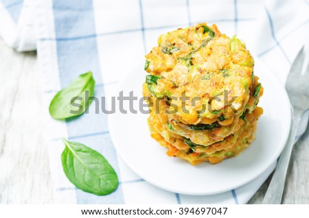 zucchini spinach chickpea burgers on white wood background. toning. selective focus - stock photo