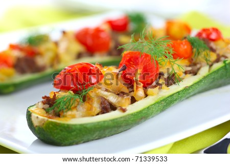 Zucchini stuffed with meat, onions and vegetables - stock photo