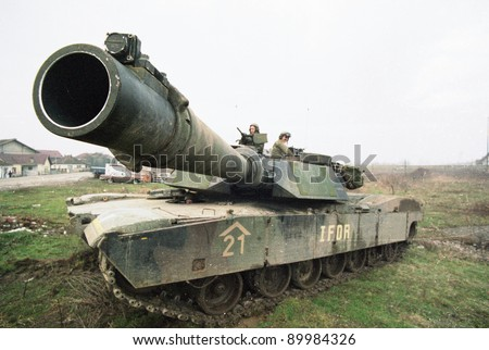 ZUPANIA, BOSNIA - JAN 22: An United States Army M1A1 tank on patrol near Zupanja, Bosnia, on Sunday, January 22, 1995.  The U.S. Army is in Bosnia as part of the United Nations peace keeping effort. - stock photo