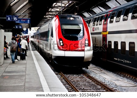 ZURICH-APRIL 21: Zurich HB train station on April 21, 2012. The station is one of the oldest railway stations in Switzerland serving more than 2,900 trains per day. - stock photo