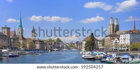 Zurich cityscape - view along the Limmat river in spring - stock photo