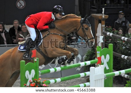 ZURICH - JANUARY 31: Niklaus Rutschi (SUI) in action during the ROLEX FEI World Cup on January 31, 2010 in Zurich. - stock photo
