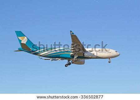 ZURICH - JULY 18: Oman Air A-330 landing in Zurich airport after intercontinental flight on July 18, 2015 in Zurich, Switzerland. Zurich airport is home for Swiss Air and one of the european hubs. - stock photo