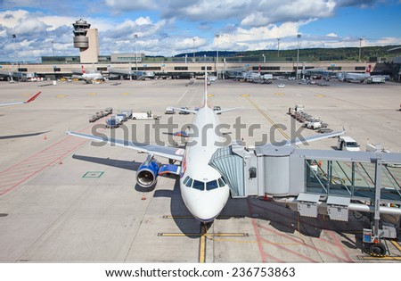 ZURICH - SEPTEMBER 21: British Airways A-330 preparing for flight on September 21, 2014 in Zurich, Switzerland. Zurich airport is home port for Swiss Air and one of the biggest european hubs. - stock photo