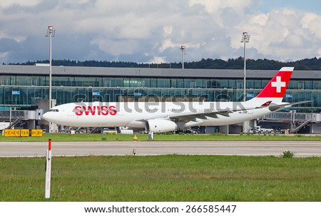 ZURICH - September 21:  Planes preparing for take off at Terminal A of Zurich Airport on September 21, 2014 in Zurich, Switzerland. Zurich airport is one of the biggest European hubs. - stock photo