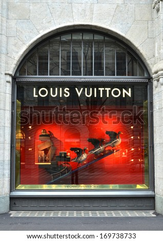 ZURICH, SWITZERLAND - DECEMBER 29, 2013 - Louis Vuitton shop, well known for its luxury trunks, leather goods, shoes, watches, jewelry and accessories - stock photo