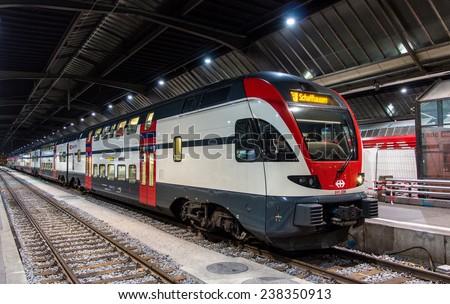 ZURICH, SWITZERLAND - DECEMBER 01: Stadler KISS, a bilevel commuter train at Zurich main station on December 1, 2013.  Swiss Federal Railways has ordered 50 such trains for the Zurich S-Bahn. - stock photo
