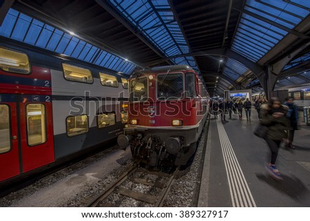 ZURICH, SWITZERLAND - FEBRUARY 23, 2016: Electric locomotive Re 4/4 at Zurich Central station, one of the busiest stations in the world. - stock photo