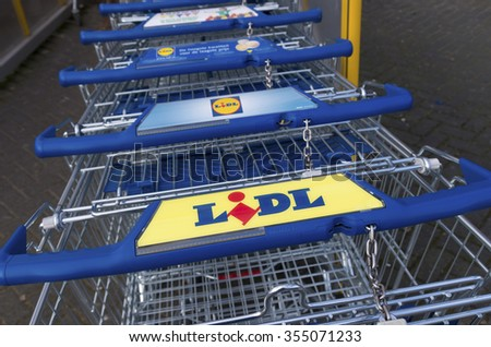 ZWOLLE, NETHERLANDS - MARCH 22, 2015: Lidl shopping carts. The company is active in a large part  of Europe, with around 8000 stores in more than 23 countries. - stock photo